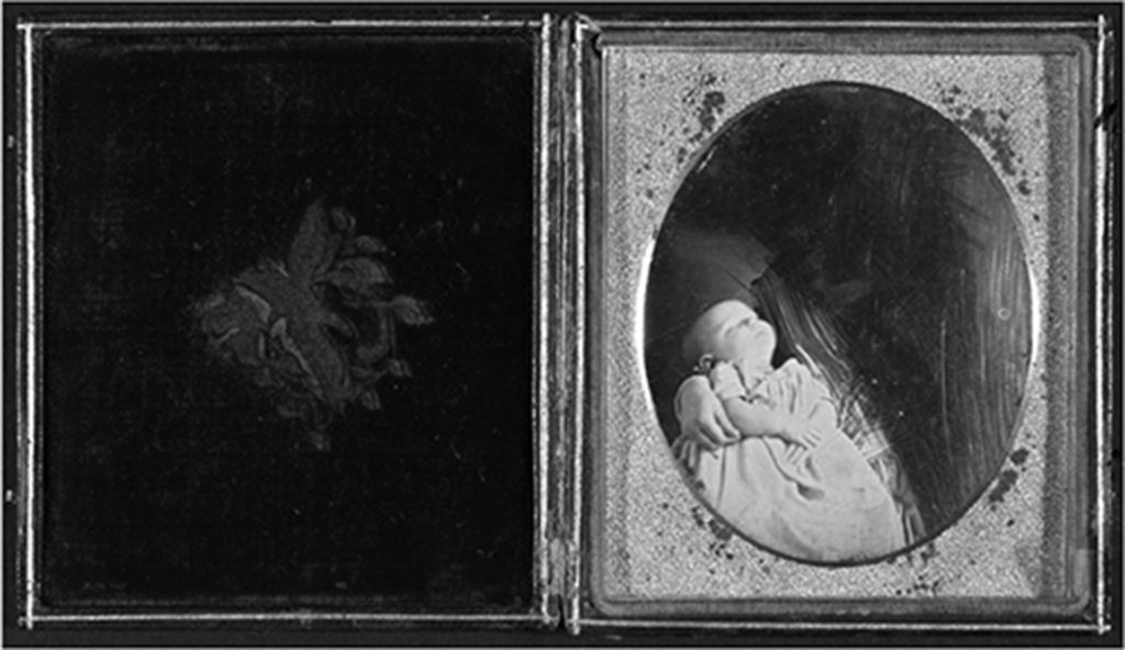 Unidentified Photographer, Deceased child held by excised woman, ca. 1845. Daguerreotype with applied colour. Courtesy of George Eastman House.