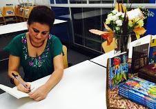 Nilofar Shidmehr signing a copy of Shirin and Salt Man