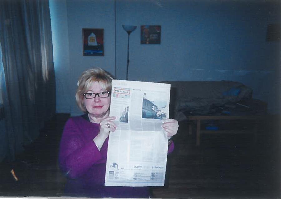 Photograph of Rebecca Papuvaru's mother holding a newspaper